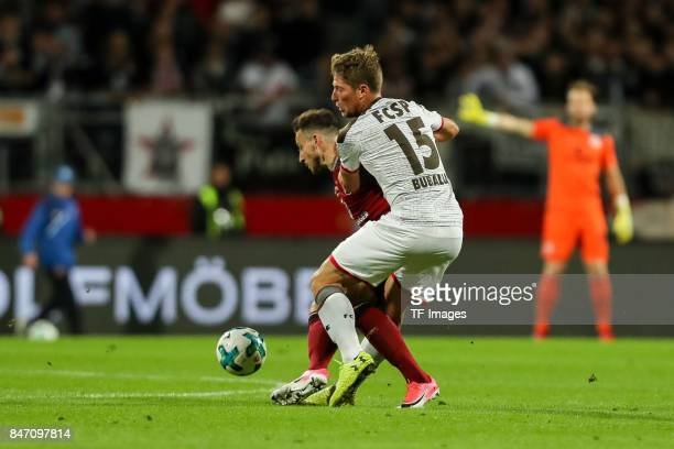 Kevin Moehwald of Nuernberg und Daniel Buballa of St Pauli battle for the ball during the Second Bundesliga match between 1 FC Nuernberg and FC St...