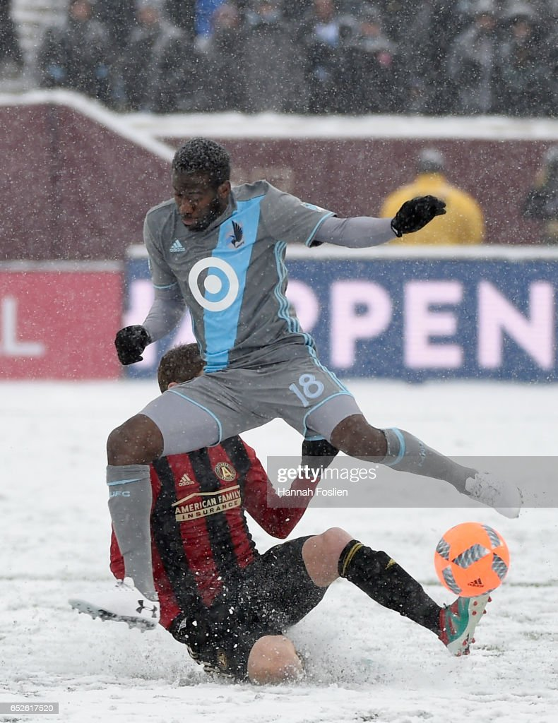 Kevin Molino #18 of Minnesota United FC jumps over Chris McCann #16 of Atlanta United FC during the second half of the match on March 12, 2017 at TCF Bank Stadium in Minneapolis, Minnesota. Atlanta defeated Minnesota 6-1.