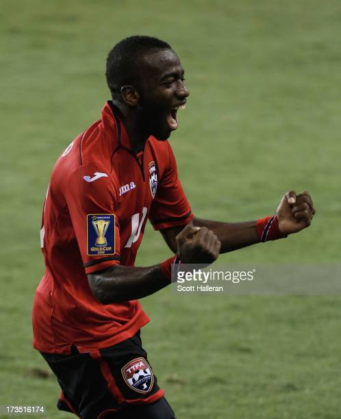 Kevin Molino of Trinidad Tobago celebrates a second half goal against Honduras during the CONCACAF Gold Cup game at BBVA Compass Stadium on July 15...