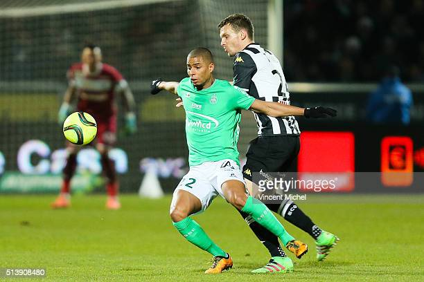 Kevin Monnet Paquet of Saint Etienne and Romain Thomas of Angers during the French Ligue 1 match between Angers SCO v AS SaintEtienne at Stade...