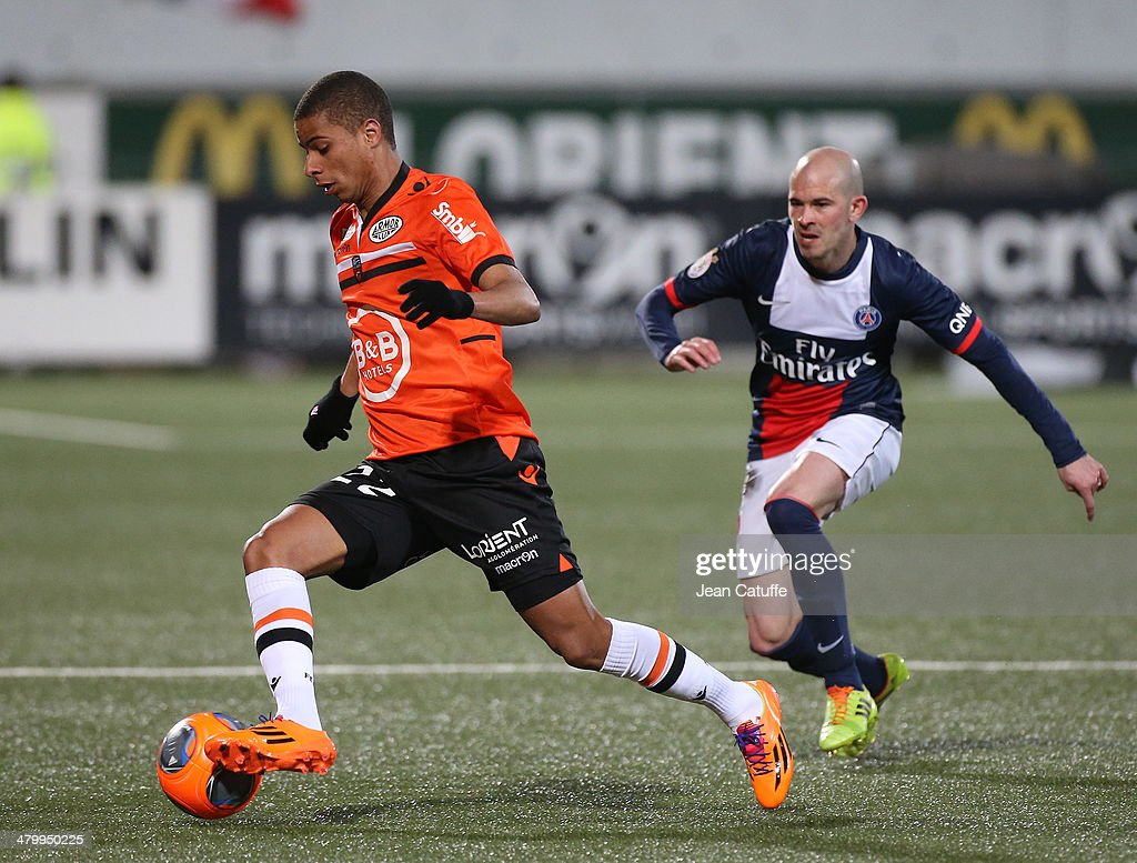 <a gi-track='captionPersonalityLinkClicked' href=/galleries/search?phrase=Kevin+Monnet-Paquet&family=editorial&specificpeople=4044138 ng-click='$event.stopPropagation()'>Kevin Monnet-Paquet</a> of Lorient and <a gi-track='captionPersonalityLinkClicked' href=/galleries/search?phrase=Christophe+Jallet&family=editorial&specificpeople=2264495 ng-click='$event.stopPropagation()'>Christophe Jallet</a> of PSG in action during the french Ligue 1 match between FC Lorient and Paris Saint-Germain FC at Stade du Moustoir on March 21, 2014 in Lorient, France.