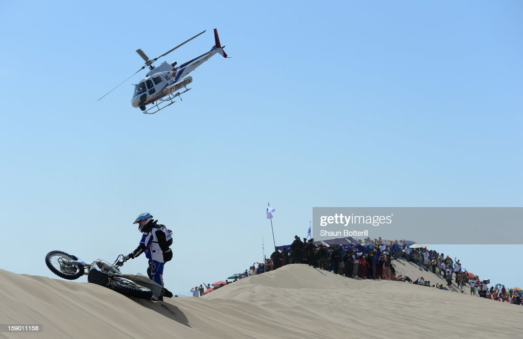 Kevin Muggleton of team Redverz is stranded during the special stage of day one of the of the 2013 Dakar Rally on January 5, 2013 in Pisco, Peru.