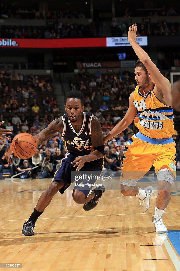 Kevin Murphy #55 of the Utah Jazz controls the ball against Evan Fournier #94 of the Denver Nuggets at the Pepsi Center on November 9, 2012 in Denver, Colorado. The Nuggets defeated the Jazz 104-84.