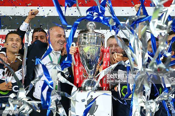 Kevin Muscat coach of the Victory Besart Berisha and Victory players celebrate after being presented with the FFA Cup after winning the FFA Cup Final...