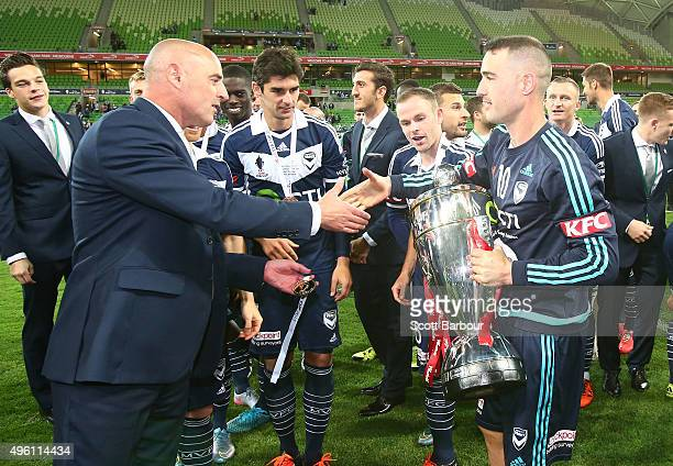 Kevin Muscat coach of the Victory presents Carl Valeri with his medal after winning the FFA Cup Final match between Melbourne Victory and Perth Glory...