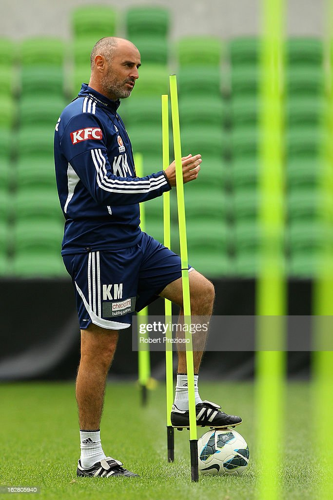 <a gi-track='captionPersonalityLinkClicked' href=/galleries/search?phrase=Kevin+Muscat&family=editorial&specificpeople=242953 ng-click='$event.stopPropagation()'>Kevin Muscat</a> looks on during a Melbourne Victory A-League training session at AAMI Park on February 28, 2013 in Melbourne, Australia.