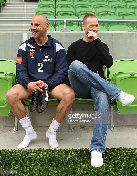 Kevin Muscat of the Victory talks with Socceroo Craig Moore after a Melbourne Victory ALeague training session at AAMI Park on May 13 2010 in...
