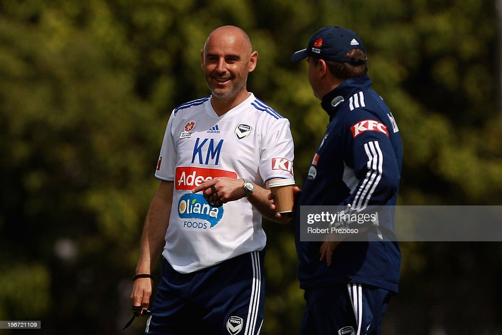 <a gi-track='captionPersonalityLinkClicked' href=/galleries/search?phrase=Kevin+Muscat&family=editorial&specificpeople=242953 ng-click='$event.stopPropagation()'>Kevin Muscat</a> talks with Ange Postecoglou during a Melbourne Victory A-League training session at Gosch's Paddock on November 20, 2012 in Melbourne, Australia.