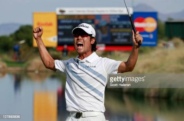 Kevin Na celebrates his twostroke victory on the 18th green during the final round of the Justin Timberlake Shriners Hospitals for Children Open at...
