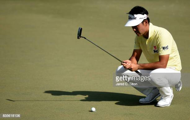Kevin Na lines up a putt on the 15th green during the third round of the Wyndham Championship at Sedgefield Country Club on August 19 2017 in...