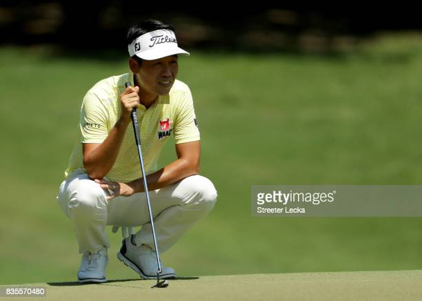 Kevin Na lines up a putt on the first hole during the third round of the Wyndham Championship at Sedgefield Country Club on August 19 2017 in...