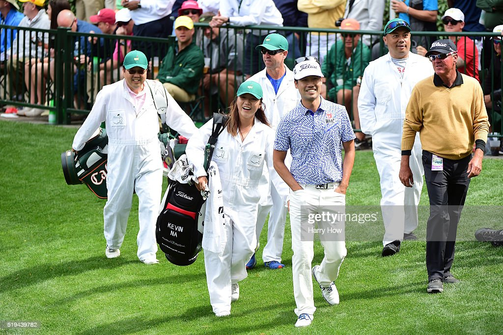 Kevin Na of the United States and Lydia Ko walk during the Par 3 Contest prior to the start of the 2016 Masters Tournament at Augusta National Golf Club on April 6, 2016 in Augusta, Georgia.