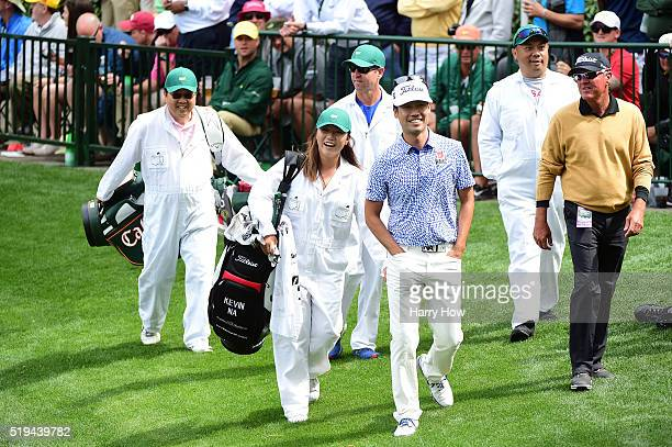 Kevin Na of the United States and Lydia Ko walk during the Par 3 Contest prior to the start of the 2016 Masters Tournament at Augusta National Golf...