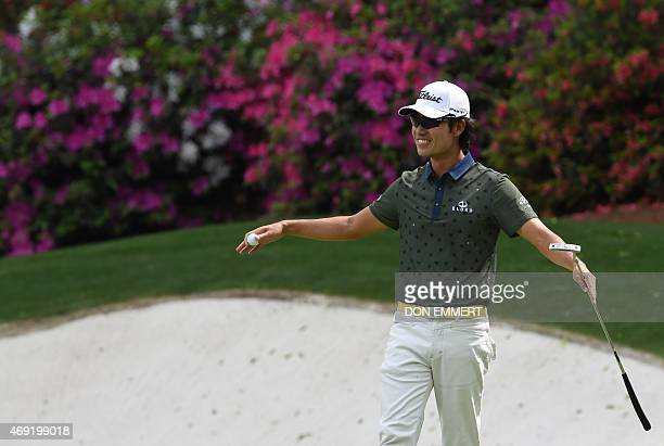 Kevin Na of the US celebrates eagle on the 13th hole during Round 2 of the 79th Masters Golf Tournament at Augusta National Golf Club on April 10 in...