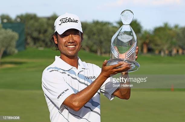 Kevin Na poses with the trophy after his twostroke victory after the final round of the Justin Timberlake Shriners Hospitals for Children Open at the...
