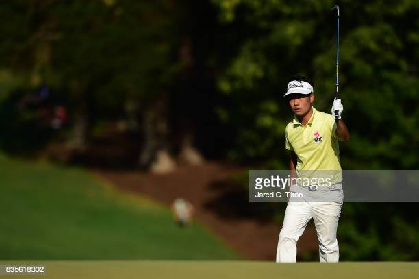 Kevin Na reacts after nearly making his birdie chip on the 18th hole during the third round of the Wyndham Championship at Sedgefield Country Club on...
