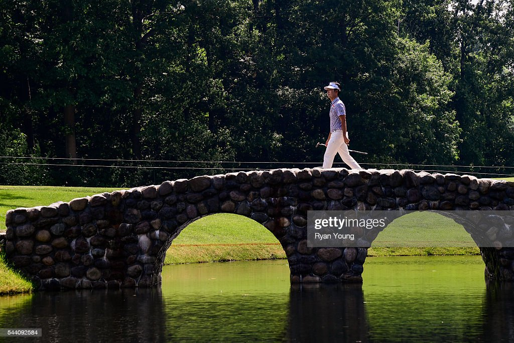 <a gi-track='captionPersonalityLinkClicked' href=/galleries/search?phrase=Kevin+Na&family=editorial&specificpeople=235605 ng-click='$event.stopPropagation()'>Kevin Na</a> walks across the bridge on the third hole during the second round of the World Golf Championships-Bridgestone Invitational at Firestone Country Club on July 1, 2016 in Akron, Ohio.