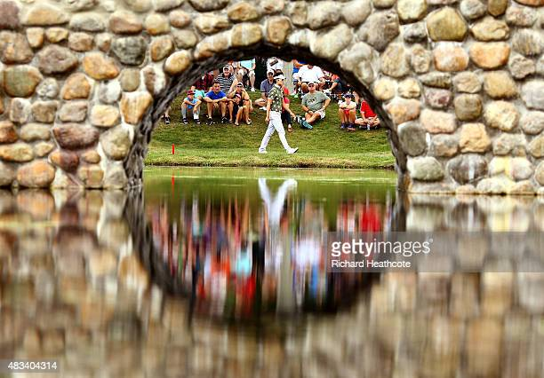Kevin Na walks to the third green during the third round of the World Golf Championships Bridgestone Invitational at Firestone Country Club South...