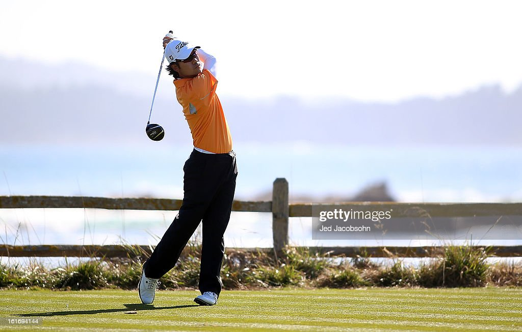 Kevin Na watches his tee shot on the 18th hole during the final round of the AT&T Pebble Beach National Pro-Am at Pebble Beach Golf Links on February 10, 2013 in Pebble Beach, California.