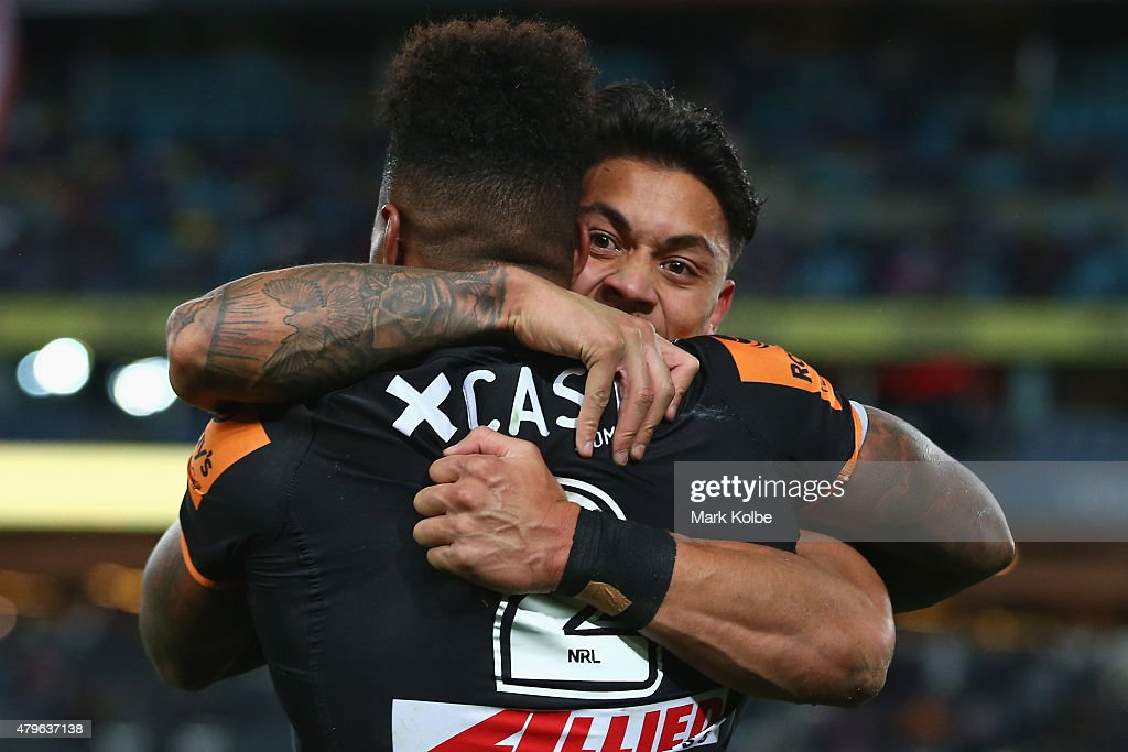 Kevin Naiqama and Delouise Hoeter of the Wests Tigers celebrate after Kevin Naiqama scored a try during the round 17 NRL match between the Wests Tigers and the Parramatta Eels at ANZ Stadium on July 6, 2015 in Sydney, Australia.