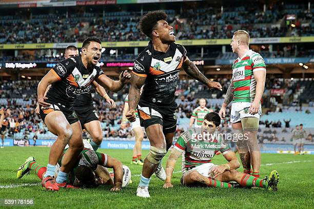 Kevin Naiqama of the Tigers celebrates scoring a try during the round 14 NRL match between the Wests Tigers and the South Sydney Rabbitohs at ANZ...