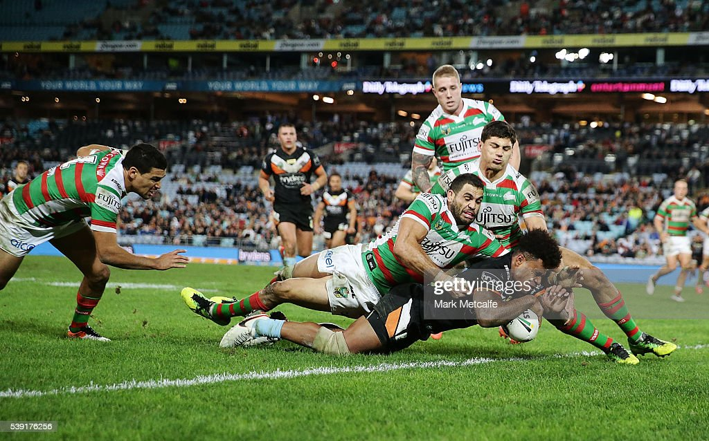 Kevin Naiqama of the Tigers scores a try during the round 14 NRL match between the Wests Tigers and the South Sydney Rabbitohs at ANZ Stadium on June 10, 2016 in Sydney, Australia.