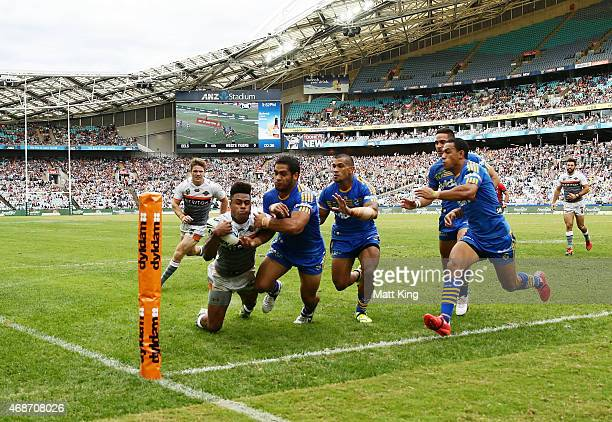 Kevin Naiqama of the Tigers scores a try in the corner during the round five NRL match between the Parramatta Eels and the Wests Tigers at ANZ...