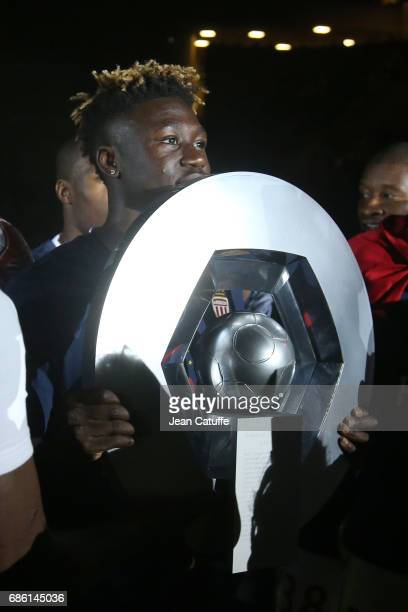 Kevin NDoram of Monaco holds the trophy during the French League 1 Championship title celebration following the French Ligue 1 match between AS...
