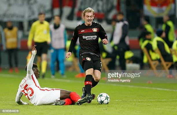 Kevin N'Doram of Monaco in action against Julian Brandt of Leverkusen during the UEFA Champions League group E soccer match between Bayer Leverkusen...