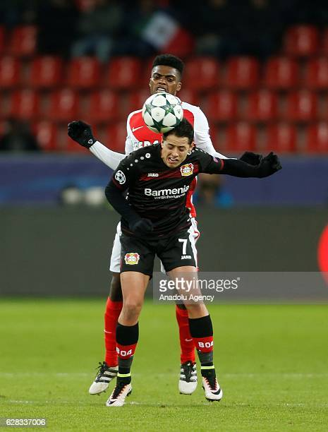 Kevin N'Doram of Monaco in action with Javier Hernandez of Leverkusen during the UEFA Champions League group E soccer match between Bayer Leverkusen...