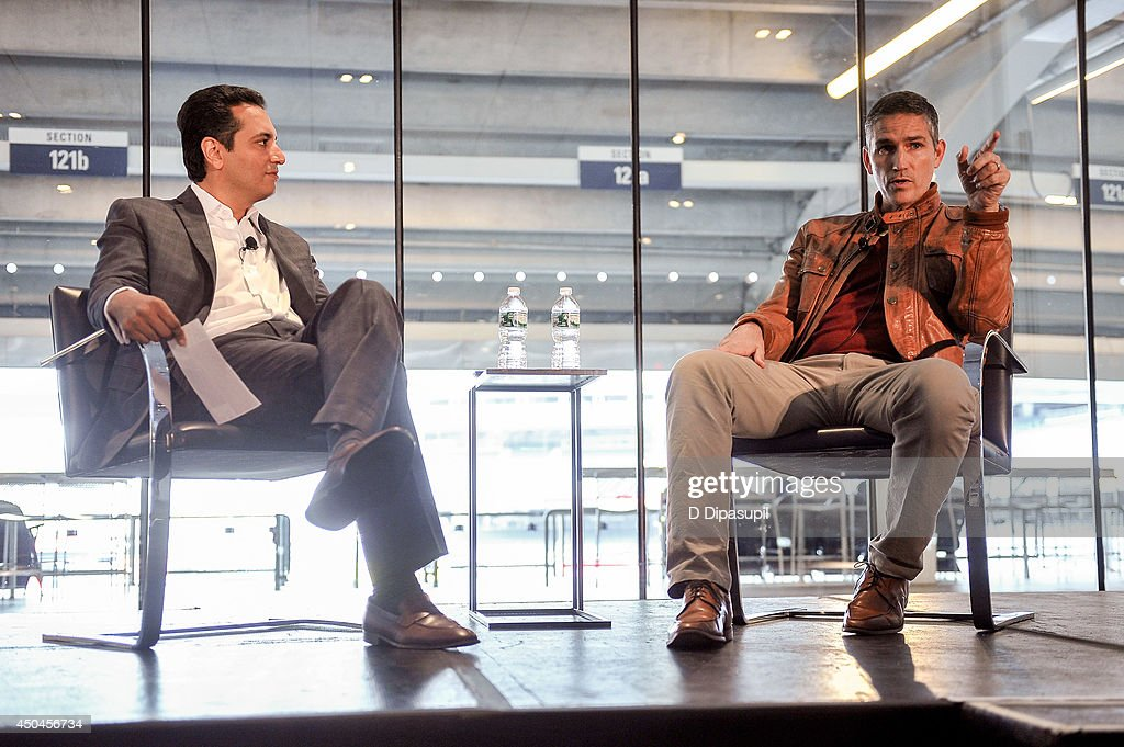 Kevin Negandhi (L) interviews Jim Caviezel during Beyond Sport United - Workshops & Panels at Yankee Stadium on June 11, 2014 in the Bronx borough of New York City.