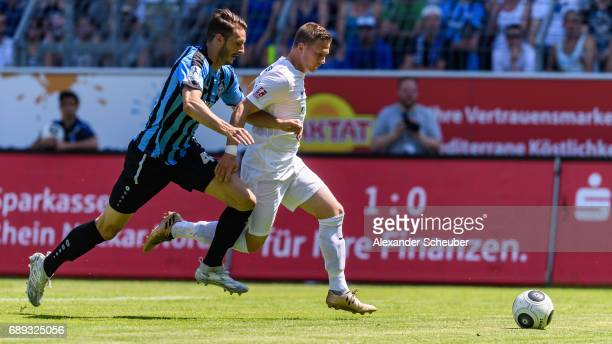 Kevin Nennhuber of Mannheim challenges Mirco Born of Meppen during the Third League playoff leg one match between Waldhof Mannheim and SV Meppen on...