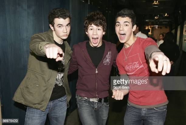 Kevin Nicholas and Joe Jonas of The Jonas Brothers pose for a photo backstage during MTV's Total Request Live at the MTV Times Square Studios March 1...