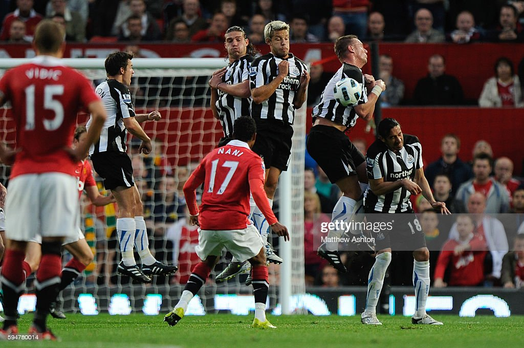 Kevin Nolan of Newcastle United blocks a free kick taken by Nani of Manchester United