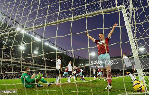 Kevin Nolan of West Ham celebrates after Cheikhou Kouyate of West Ham scored the opening goal past David De Gea of Manchester United during the...
