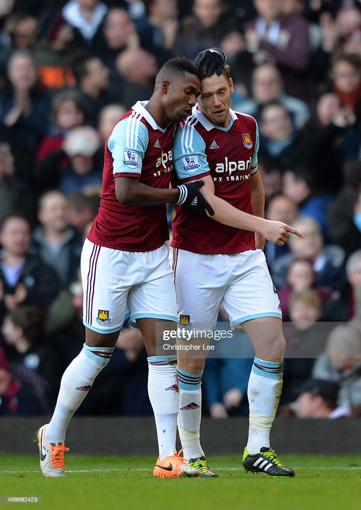 <a gi-track='captionPersonalityLinkClicked' href=/galleries/search?phrase=Kevin+Nolan&family=editorial&specificpeople=206775 ng-click='$event.stopPropagation()'>Kevin Nolan</a> of West Ham celebrates scoring Modibo Maiga of West Ham during the Barclays Premier League match between West Ham United and West Bromwich Albion at Boleyn Ground on December 28, 2013 in London, England.