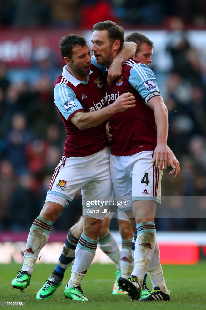 Kevin Nolan of West Ham celebrates scoring with Razvan Rat of West Ham during the Barclays Premier League match between West Ham United and West Bromwich Albion at Boleyn Ground on December 28, 2013 in London, England.