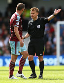 Kevin Nolan of West Ham has words with Referee Mike Jones during the Barclays Premier League match between Queens Park Rangers and West Ham United at...