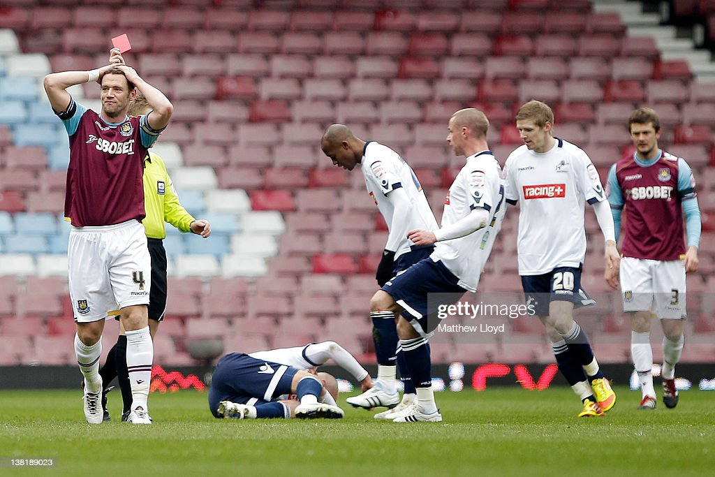 Kevin Nolan of West Ham (L) is sent off after a challenge on Jack Smith of Millwall during the npower Championship match between West Ham United and Millwall, at Boleyn Ground on February 04, 2012 in London, England.