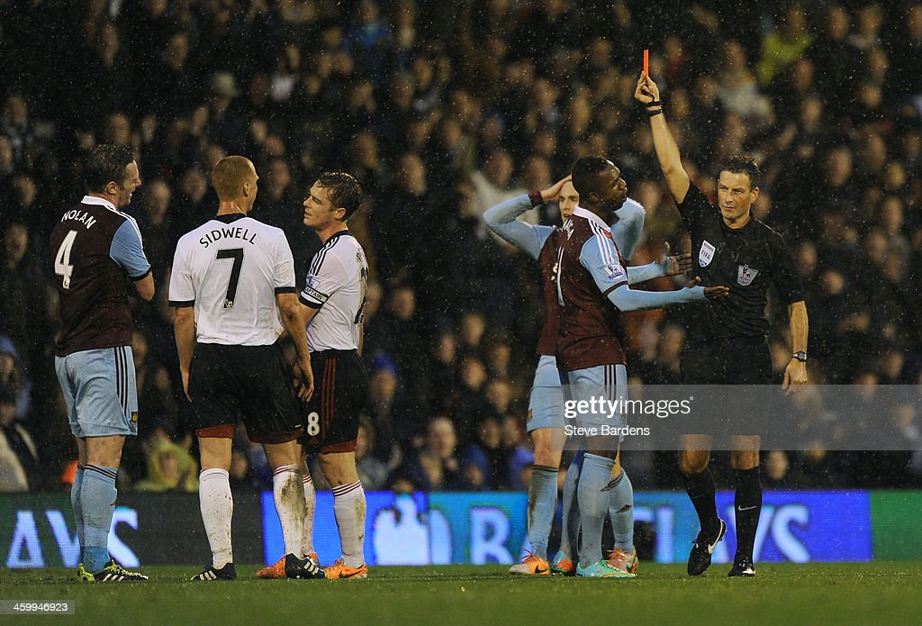 <a gi-track='captionPersonalityLinkClicked' href=/galleries/search?phrase=Kevin+Nolan&family=editorial&specificpeople=206775 ng-click='$event.stopPropagation()'>Kevin Nolan</a> #4 (L) of West Ham is shown the red card by Referee <a gi-track='captionPersonalityLinkClicked' href=/galleries/search?phrase=Mark+Clattenburg&family=editorial&specificpeople=2108870 ng-click='$event.stopPropagation()'>Mark Clattenburg</a> during the Barclays Premier League match between Fulham and West Ham United at Craven Cottage on January 1, 2014 in London, England.