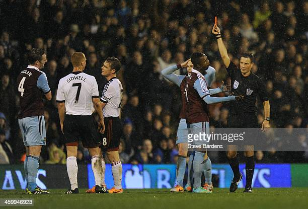 Kevin Nolan of West Ham is shown the red card by Referee Mark Clattenburg during the Barclays Premier League match between Fulham and West Ham United...