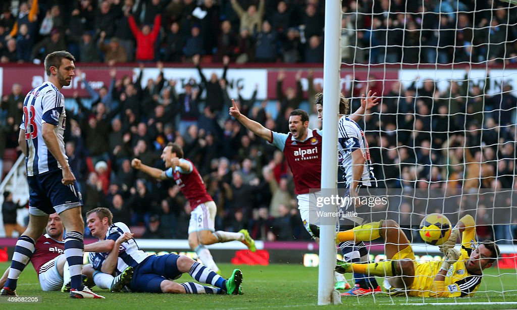 <a gi-track='captionPersonalityLinkClicked' href=/galleries/search?phrase=Kevin+Nolan&family=editorial&specificpeople=206775 ng-click='$event.stopPropagation()'>Kevin Nolan</a> of West Ham scores their third goal past Ben Foster of West Brom during the Barclays Premier League match between West Ham United and West Bromwich Albion at Boleyn Ground on December 28, 2013 in London, England.