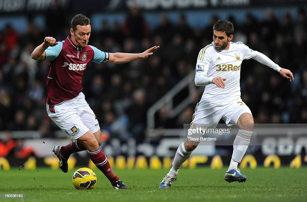 <a gi-track='captionPersonalityLinkClicked' href=/galleries/search?phrase=Kevin+Nolan&family=editorial&specificpeople=206775 ng-click='$event.stopPropagation()'>Kevin Nolan</a> of West Ham United breaks away from Angel Rangel of Swansea City during the Barclays Premier League match between West Ham United and Swansea at the Boleyn Ground on February 2, 2013 in London, England.