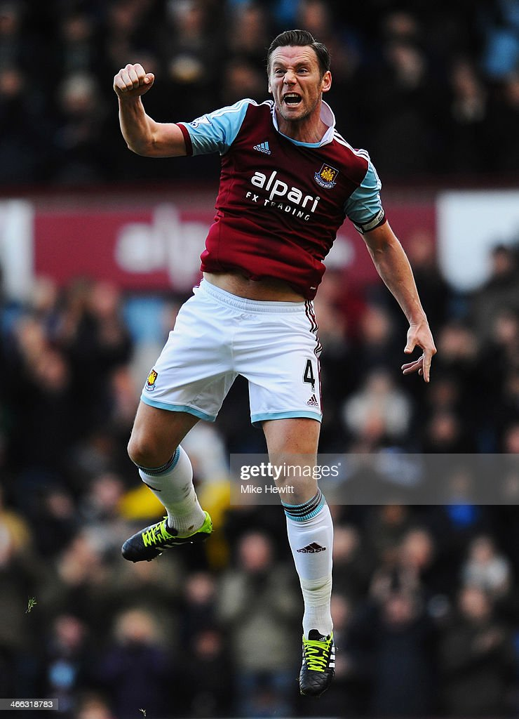 Kevin Nolan of West Ham United celebrates as he scores their first goal during the Barclays Premier League match between West Ham United and Swansea City at Boleyn Ground on February 1, 2014 in London, England.