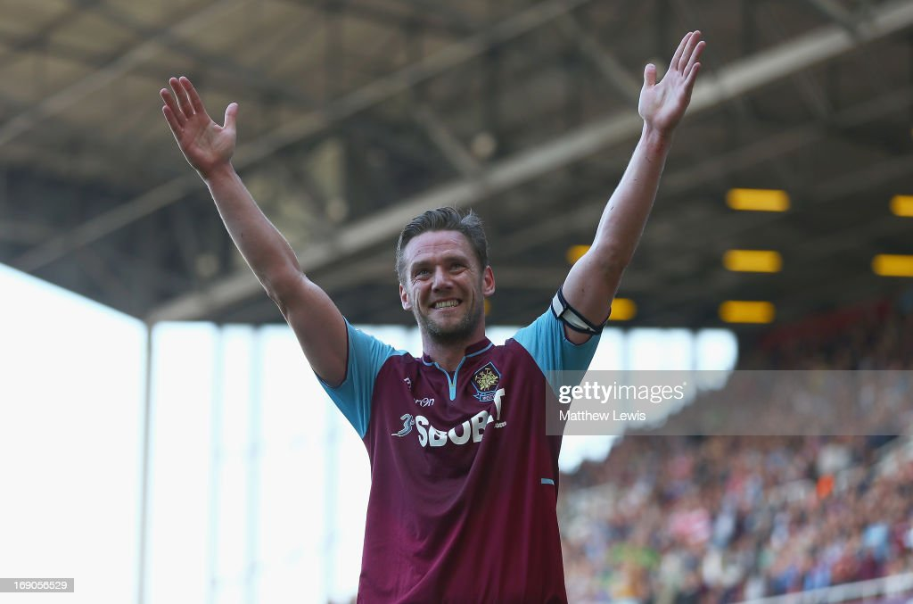 Kevin Nolan of West Ham United celebrates his hat trick during the Barclays Premier League match between West Ham United and Reading at the Boleyn...