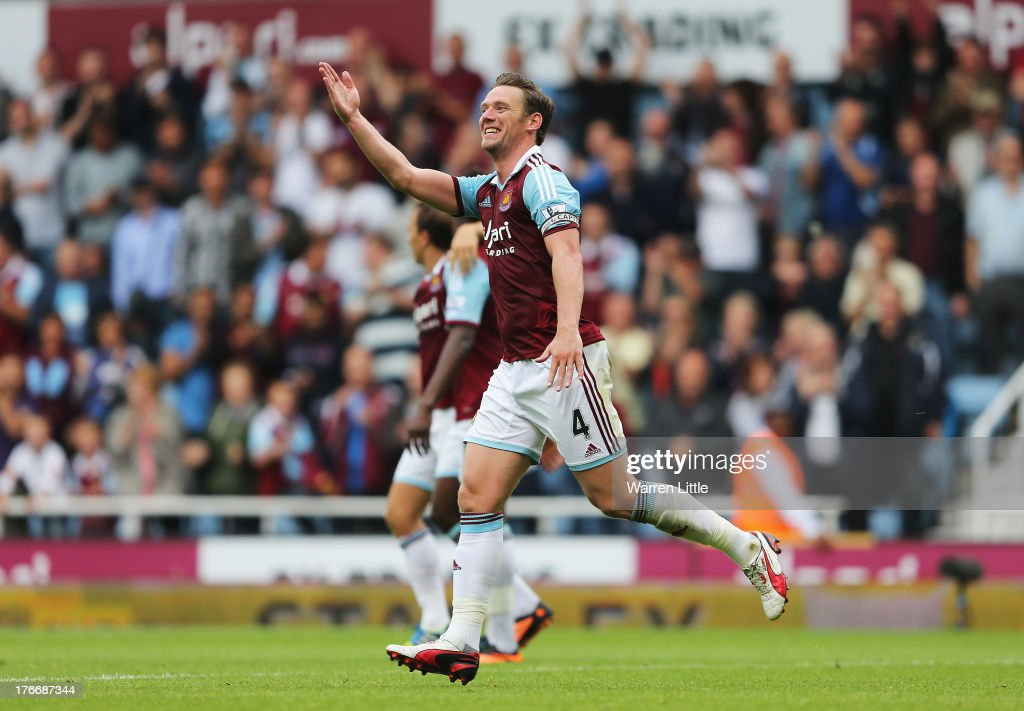 <a gi-track='captionPersonalityLinkClicked' href=/galleries/search?phrase=Kevin+Nolan&family=editorial&specificpeople=206775 ng-click='$event.stopPropagation()'>Kevin Nolan</a> of West Ham United celebrates scoring his side's second goal during the Barclays Premier League match between West Ham United and Cardiff City at Boleyn Ground on August 17, 2013 in London, England.