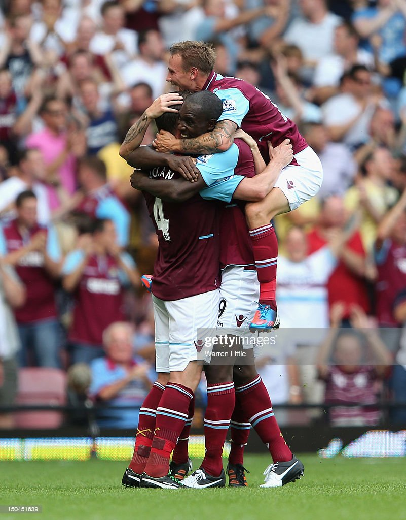<a gi-track='captionPersonalityLinkClicked' href=/galleries/search?phrase=Kevin+Nolan&family=editorial&specificpeople=206775 ng-click='$event.stopPropagation()'>Kevin Nolan</a> of West Ham United (L) celebrates with team mates <a gi-track='captionPersonalityLinkClicked' href=/galleries/search?phrase=Carlton+Cole&family=editorial&specificpeople=215313 ng-click='$event.stopPropagation()'>Carlton Cole</a> and Matthew Taylor after scoring the opening goal during the Premier League match between West Ham United and Aston Villa at the Boleyn Ground on August 18, 2012 in London, England.