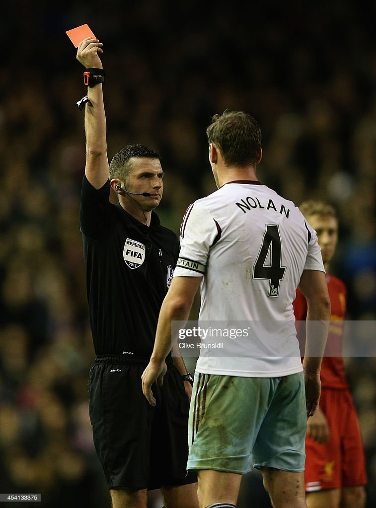 <a gi-track='captionPersonalityLinkClicked' href=/galleries/search?phrase=Kevin+Nolan&family=editorial&specificpeople=206775 ng-click='$event.stopPropagation()'>Kevin Nolan</a> of West Ham United is shown a red card by Referee Michael Oliver during the Barclays Premier League match between Liverpool and West Ham United at Anfield on December 7, 2013 in Liverpool, England.