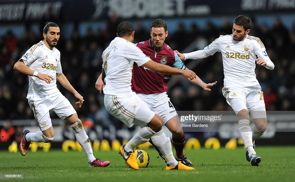 Kevin Nolan of West Ham United takes on the Swansea City defence during the Barclays Premier League match between West Ham United and Swansea at the Boleyn Ground on February 2, 2013 in London, England.