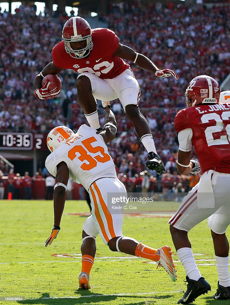 Kevin Norwood #83 of the Alabama Crimson Tide leaps over Jaron Toney #35 of the Tennessee Volunteers after a reception at Bryant-Denny Stadium on October 26, 2013 in Tuscaloosa, Alabama.